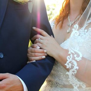 A Norman's bride and her groom arm in arm.